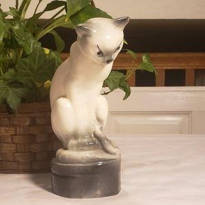 Vintage mischievous fishbowl cat figurine